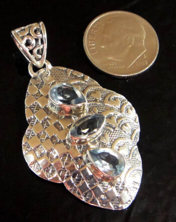 blue topaz sterling silver pendant with dime for scale