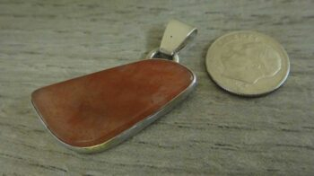 strawberry moss agate pendant with dime for size