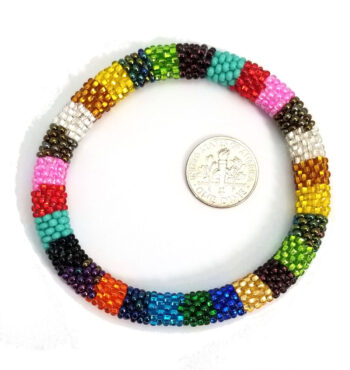 striped multi-color Czech glass seed bead roll-on bracelet with dime to help you judge scale