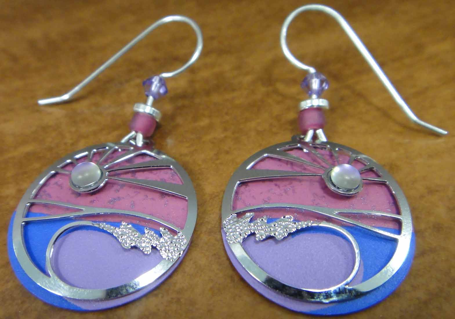 These pink and purple sunset and ocean earrings are handmade by Adajio.