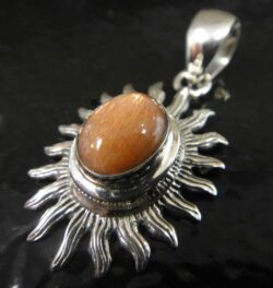 sunstone cabochon and sterling silver pendant shaped like sun