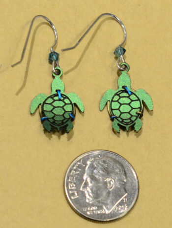 back of teal and green sea turtle Sienna Sky earrings with dime