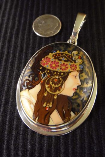 Alphonse Mucha's The Brunette hand painted onyx and sterling silver oval pendant with dime for size