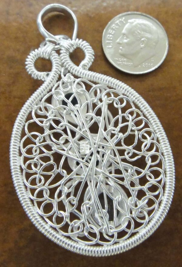 back of blue topaz wire wrapped pendant