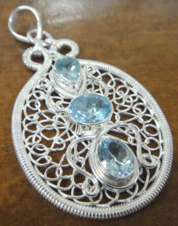 Blue topaz sterling silver wire wrapped pendant