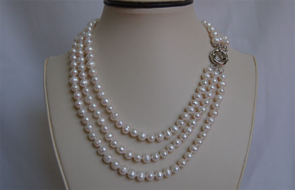 three strand pearl necklace turned so you can see clasp