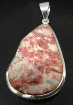 Rough thulite and sterling silver pendant