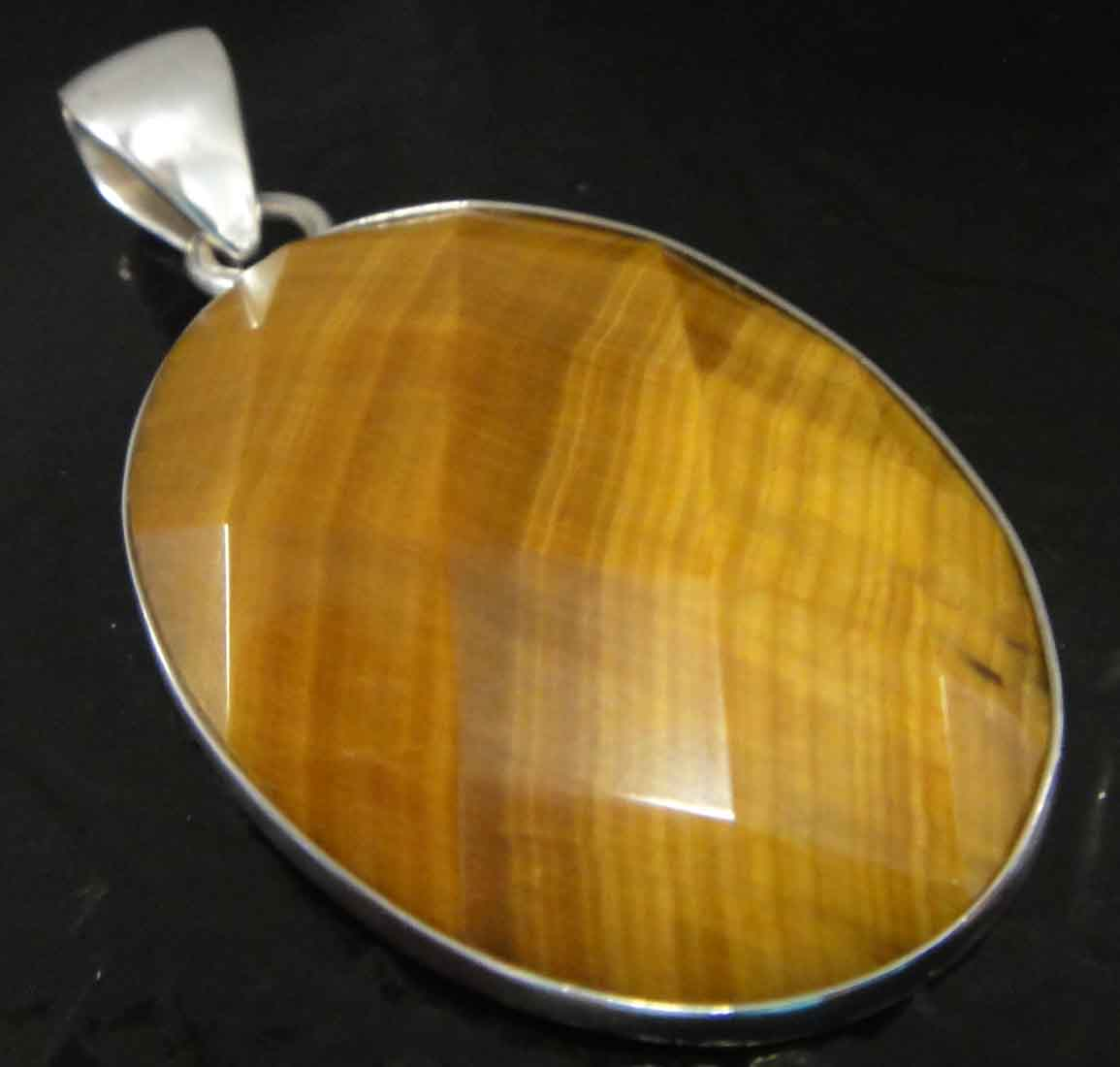 Handmade faceted oval tiger's eye and .950 sterling silver pendant