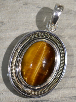 handmade oval tiger's eye pendant set in sterling silver with bronze accents