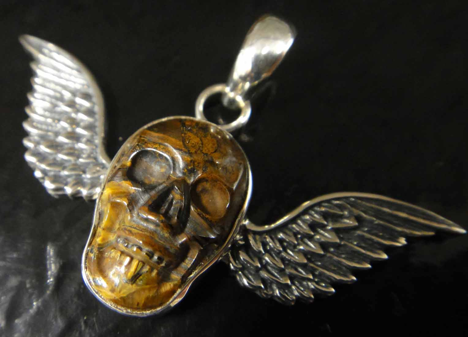 tiger's iron sterling silver winged skull pendant