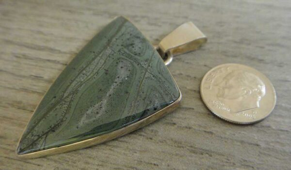 tinguaite pendant with dime for size