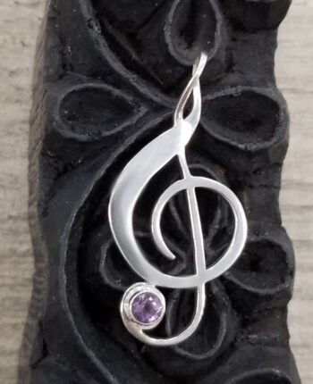 Treble clef sterling silver and amethyst pendant