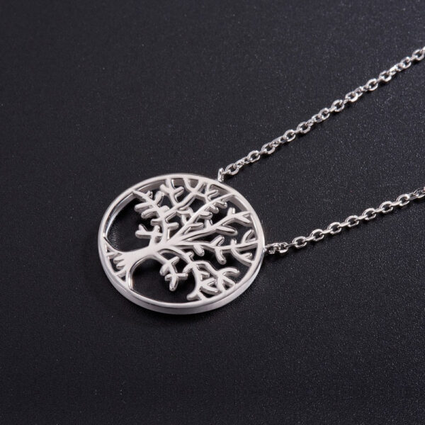 tree of life sterling silver necklace on black background