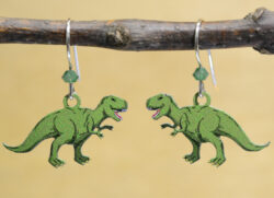 green T. rex dinosaur Sienna Sky earrings
