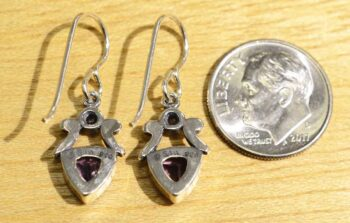 Back of triangle amethyst and pearl earrings (pictured with dime for scale)