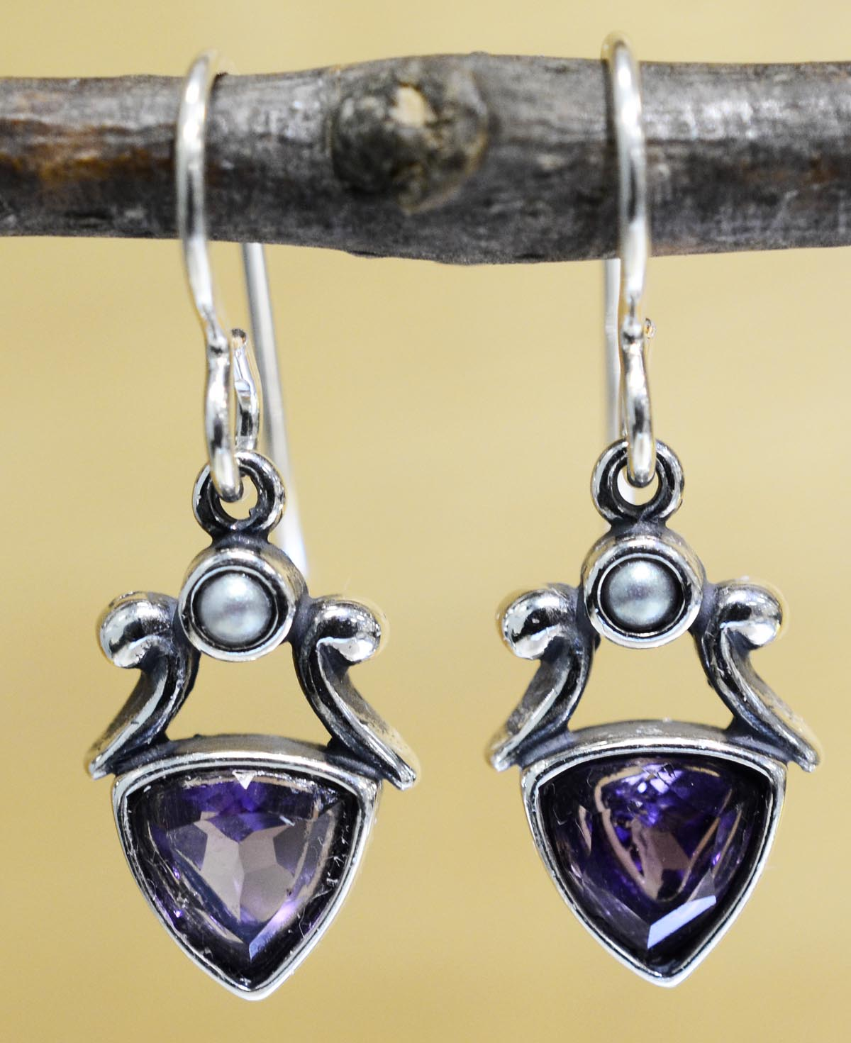 These triangle amethyst and pearl earrings are handmade by Sonoma Art Works.