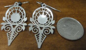 Back of silver-tone art deco earrings shown with dime for scale