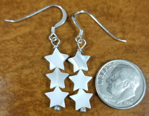 triple star earrings with dime for scale