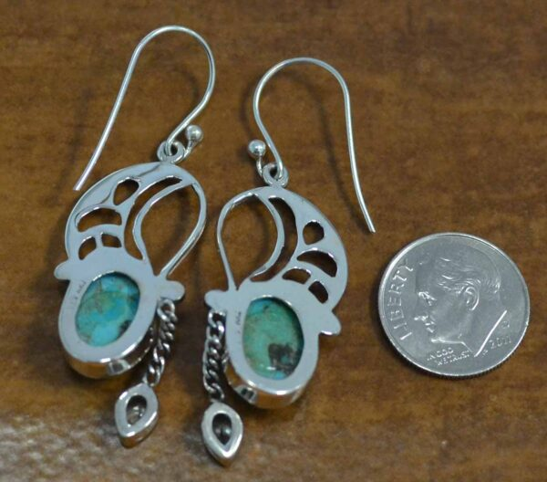 back of turquoise and blue topaz sterling silver earrings with dime for scale