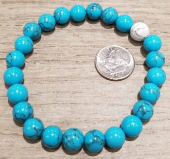 blue synthetic turquoise, white howlite bracelet with dime for size
