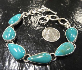 turquoise and sterling silver bracelet with dime for scale