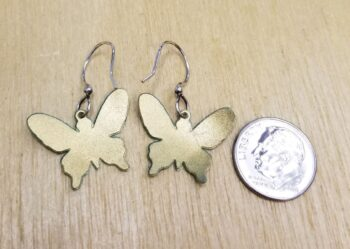 back of butterfly earrings with dime for scale