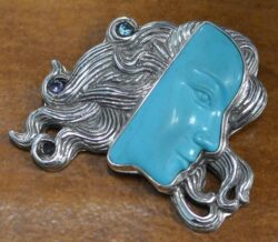 turquoise carved face and sterling silver handmade pendant