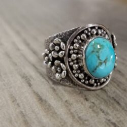 turquoise ring with silver flowers