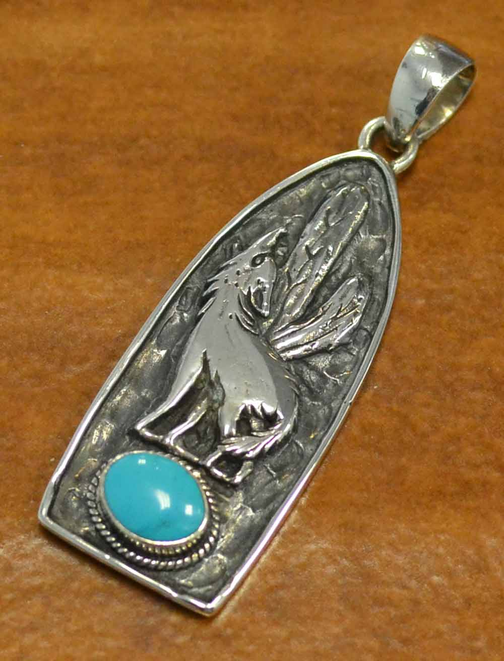 turquoise and sterling silver howling wolf pendant