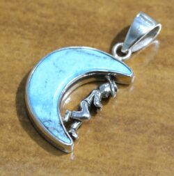 turquoise moon and sterling silver cowboy pendant