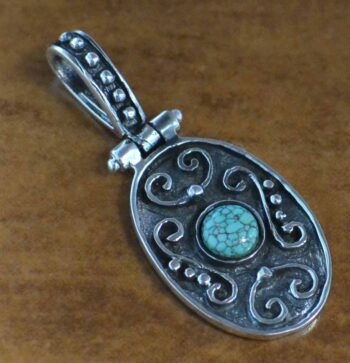 handmade turquoise and detailed sterling silver oval pendant