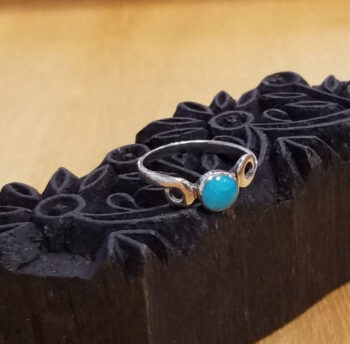 turquoise ring with silver swirls