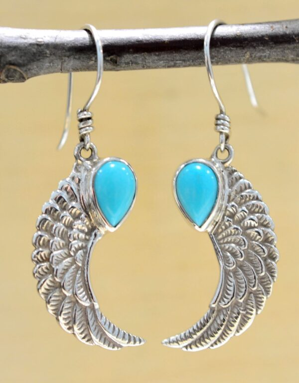 Bright blue turquoise and detailed .925 sterling silver wing earrings
