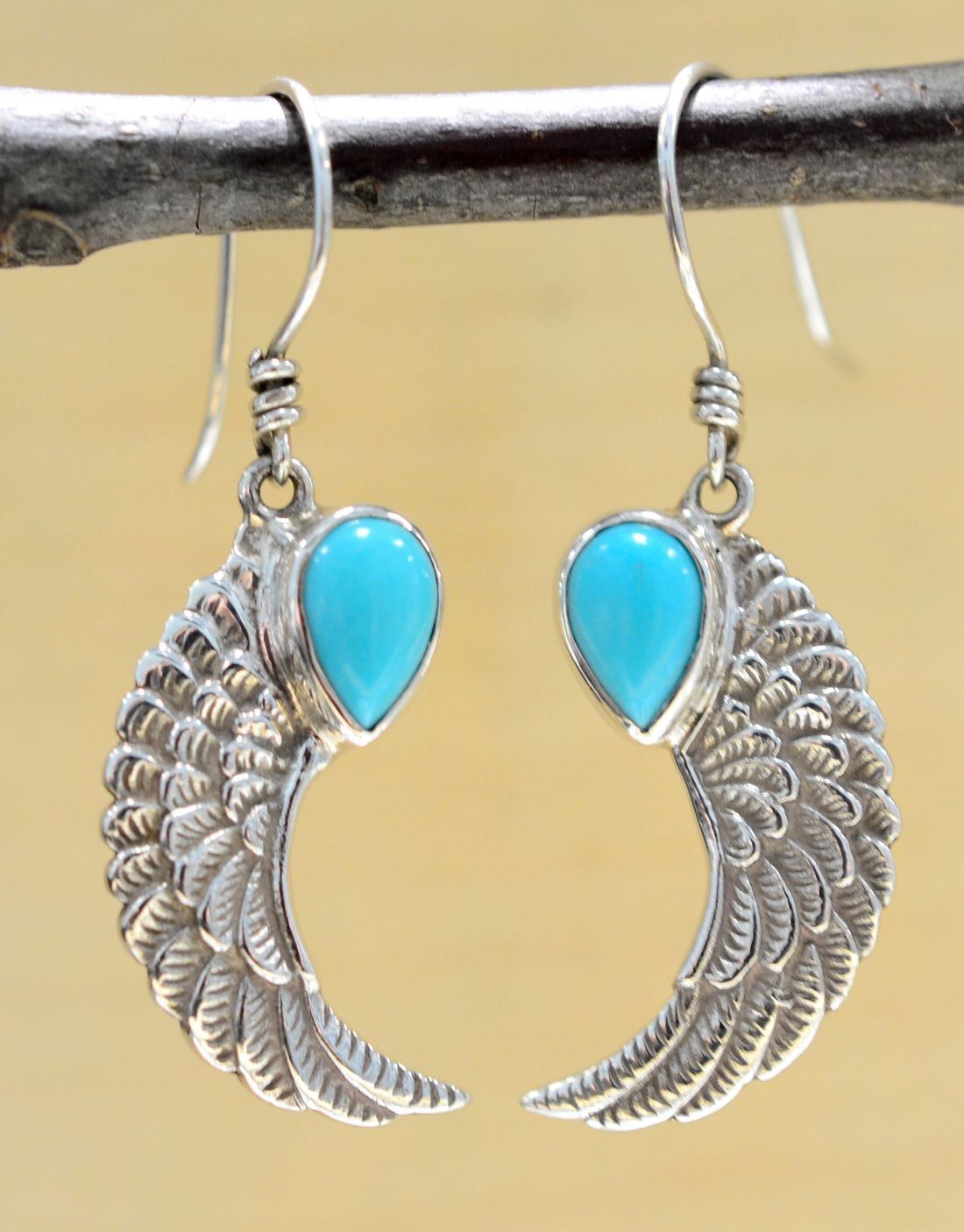dbf9344d8 Bright blue turquoise and detailed .925 sterling silver wing dangle ...