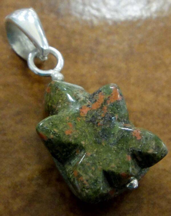 back of carved unakite turtle pendant