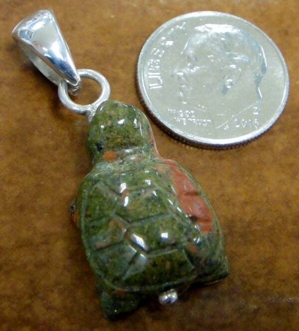 carved unakite turtle pendant with dime for size