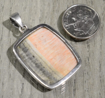 back of barite rectangle pendant with dime