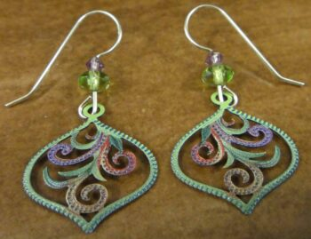 These green and multicolored earrings are handmade by Adajio.