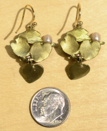 Back of Michael Michaud Water Lily dangle earrings, shown with dime (not included) for scale