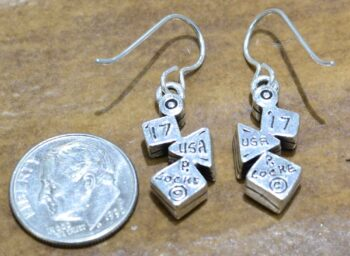 back of Flurry earrings by Patricia Locke with dime for size