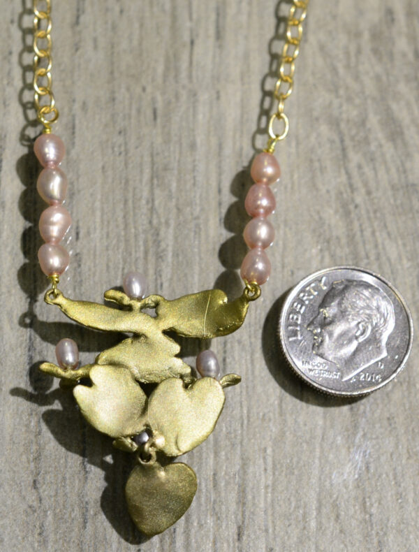 Michael Michaud Silver Seasons water lily necklace, back view, shown with dime (not included) for scale