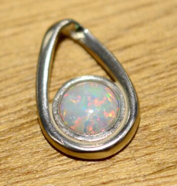 handmade created white opal and sterling silver pendant