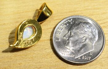 Back view of Handmade created white opal and 14k gold vermeil pendant, shown with dime (not included) for scale