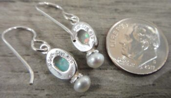 back of handmade opal and freshwater pearl drop style earrings with dime