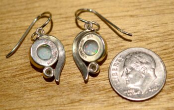 back of white opal drop earrings with dime