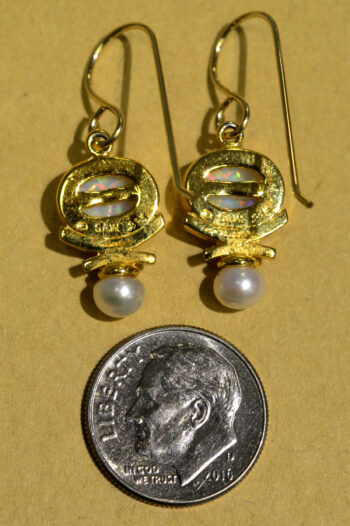 back of Sierra Designs white opal, white freshwater pearl, and 14k gold vermeil drop earrings with dime