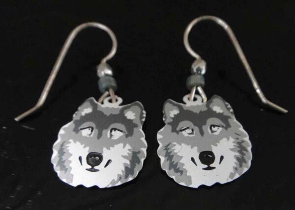 These gray and white wolf earrings are handmade by Sienna Sky.