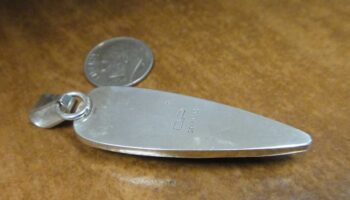 back of elongated point writing stone pendant with dime for size