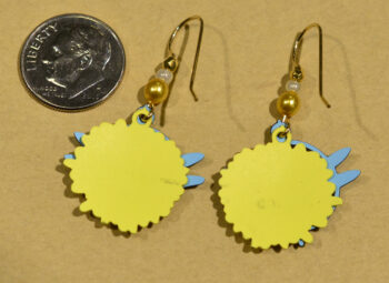 back of yellow flower and blue dragonfly dangle earrings with dime