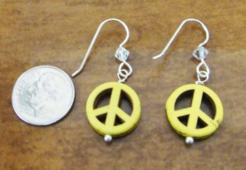 yellow peace sign earrings with dime for size